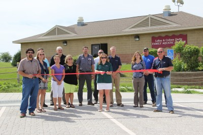Monona Barb Collins cuts the ribbon for the new aquatic center parking lot