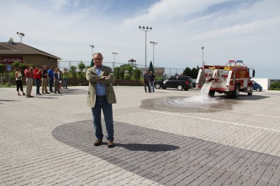 Urban Conservationist Wayne Peterson was present as 2,000 gallons of water were poured onto the new parking lot as a demonstration of the permeable ability of the new surface